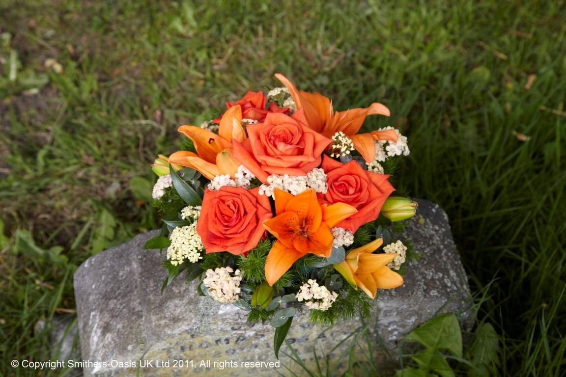 Orange Posy Funeral Flowers Leeds